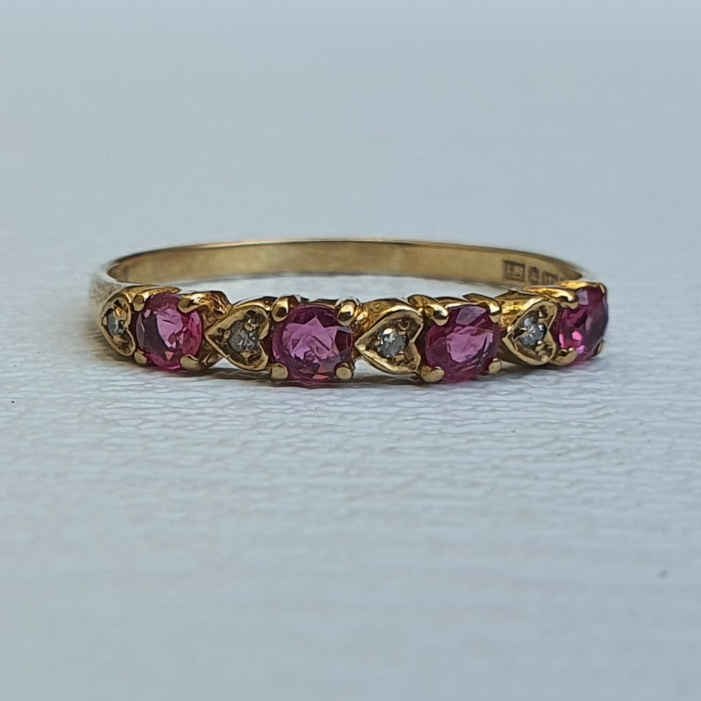 Product photo for 1.09g 9ct Yellow Gold 4 Ruby 4 Tiny White Stones Half Band Ring Size N